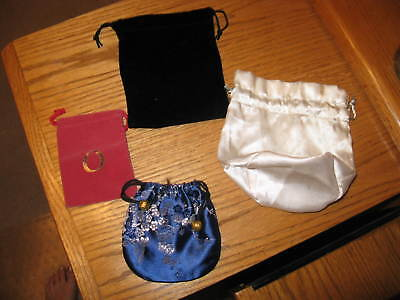 four jewelry pouches/bags one blue Oriental, black,  beige, red draw string