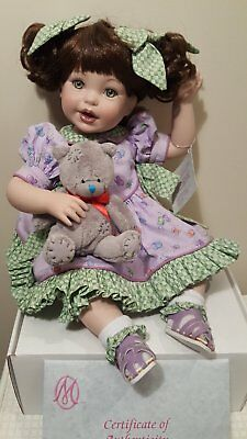 """Lovely Porcelin Doll sitting 12"""" by artist. COA, original box, Excellent as new!"""