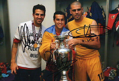 "Cesc Fabregas,Pedro + Victor Valdes Hand Signed Spain 12"" x 8"" Football Photo."