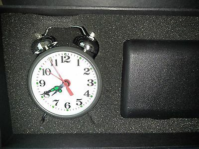 Old Fashioned metal Alarm Clock Wind Up with universal travel adapters kit