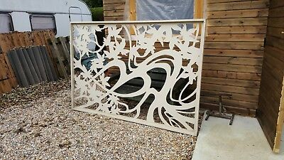 A pair of MDF Fretwork Panels 5 ft x 7 ft 4 in with timber surround