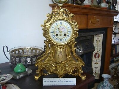 19th Century French gilt metal/marble Mantle clock. Rococo style. Porcelain dial