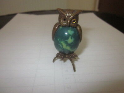 Rare brass and celluloid owl shaped sewing measuring tape.