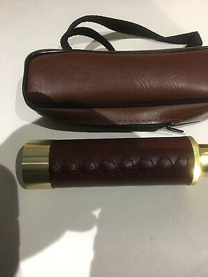 A SMALL BRASS CAPTAINS THREE  DRAWER TELESCOPE 13mm x26mm extended with case
