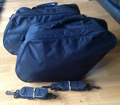 A Pair Of Triumph Rocket 111 Pannier Bags / Liners Excellent Condition.