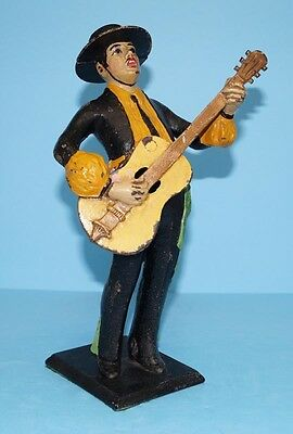 ANTIQUE TROUBADOUR W/ GUITAR CAST IRON DOORSTOP METAL ART SIGNED LVL CA. 1920's