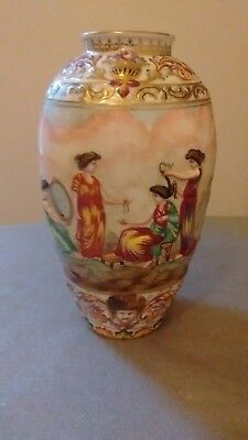 vintage Japanese vase with raised figures all round  ( small chip on rim )