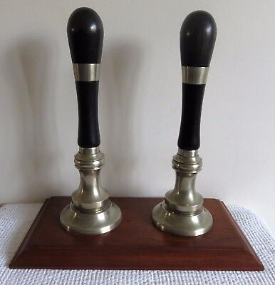 2 superb Ebonised Wood & Bronze Hand Pull Beer Pump Handles, on an Oak Plinth.