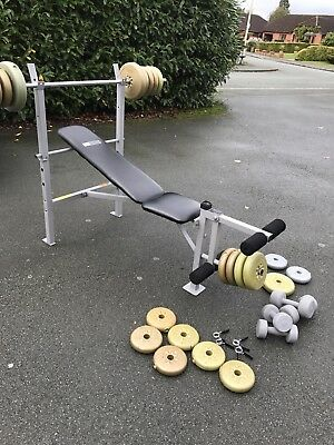 Weight bench and 50kg weights plus bars