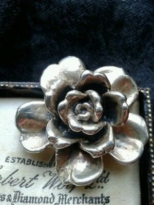 sterling silver rose pin.