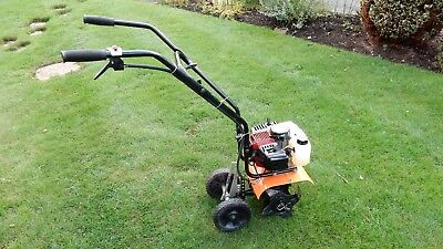Senua rotovator with 25cc two stroke engine in good condition.