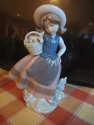 Lladro figure of girl standing with basket of flowers 5221 - stands 16cm high