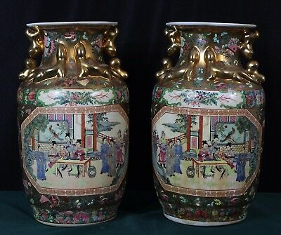 A pair of gold gilt vintage Chinese vases