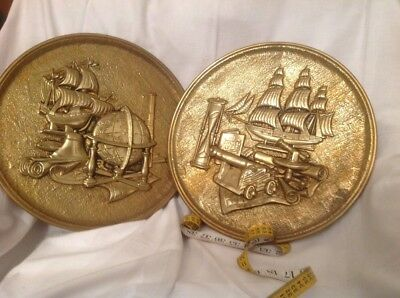 2 large brass wall plaqes