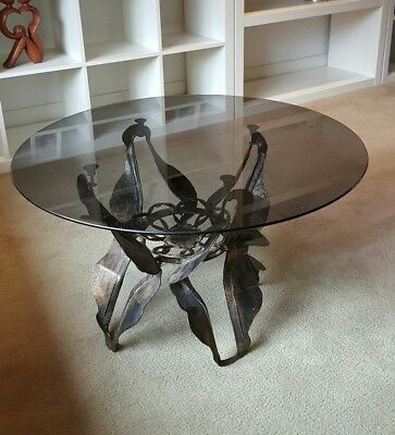 retro vintage glass top coffee table on metal sculptured base