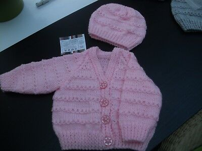 hand knitted baby cardigan and hat
