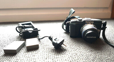 Olympus PEN E-PL2 with 14-42mm lens and two batteries