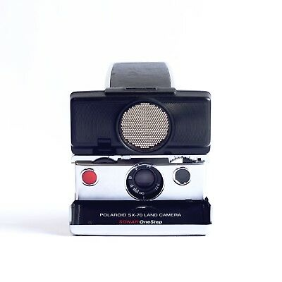 Sx-70 Sonar Onestep Polaroid camera with autofocus and 6 months warranty