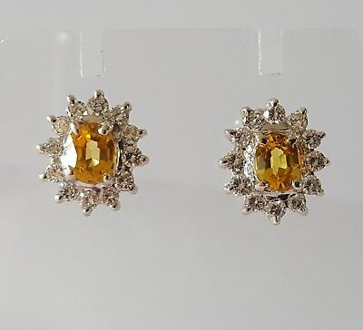Pair of 18ct white gold yellow sapphire and diamond cluster earrings.