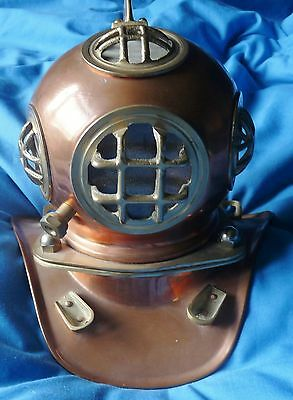 A miniature copper and brass divers helmet