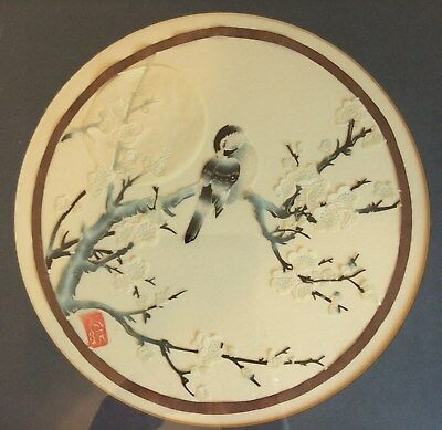 Vintage Japanese cut paper picture of bird perched on blossom
