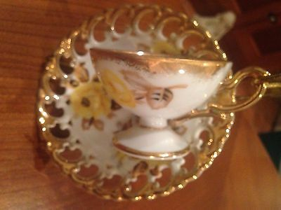 Delicate bone china yellow rose with gold trim cup and saucer with cut outs