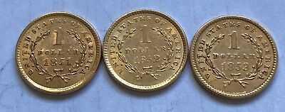 Four US $1.00 Gold Dollar Coins with jewelry-use damage