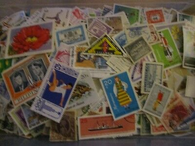 150 Different Worldwide Stamps Off Paper.