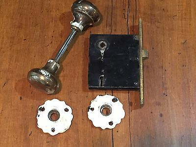 Antique Door Hardware Mortise Lock with Brass Knobs and Ornate Backing Plates