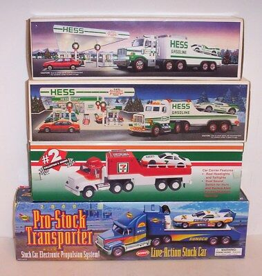 4 Brand New Toy Transporter Trucks With Cars  /  Hess , 7 Eleven , Sunoco , Hess