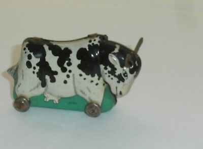 Vintage Tin on Wheels Toy Cow With Horns Utters Bobblehead Nodder 3x2 Inch