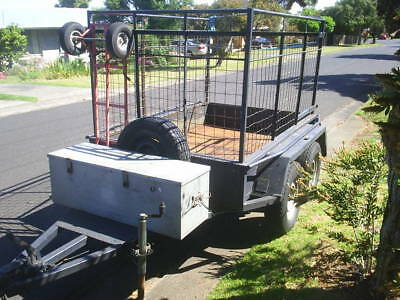 TANDEM TRAILER WITH CAGE. RATED TO 2000kg. VIC REG. 99 cent start. NO RESEVE.