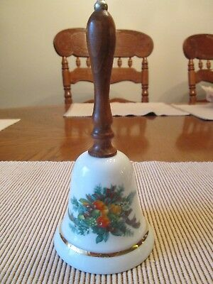 1985 Avon white porcelain Christmas bell with porcelain clapper and wood handle