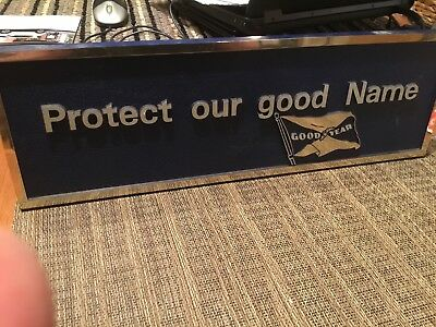 GOOD YEAR sign (Protect our good name plaque)