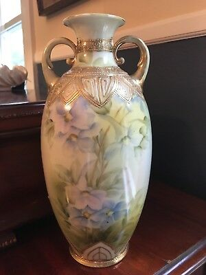 Antique porcelain hand painted vase with gold trim