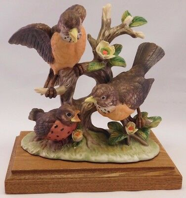 """Bisque Porcelain Bird Figurines: Wood Base - """"Family of Robins"""""""