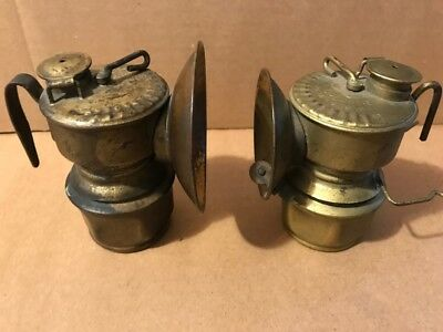 Miners mining Guys dropper carbide cap lamps