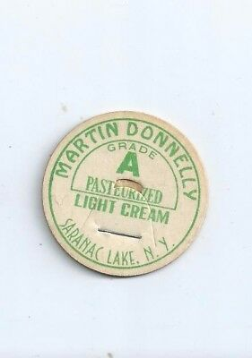 """Martin Donnelly""   Saranac Lake, N.Y.  milk bottle cap."
