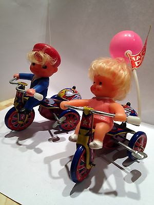 Pair Of Old Tin Wind Up Litho toys Boy And Girl On Tricycles