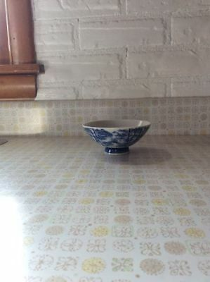 Vintage Japanese Hand painted footed rice bowl, signed by artist. Blue on white.