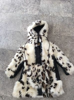 vintage 1960s girls fur coat with mstching handmuffs Styled by Adrian Marsh