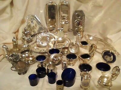 A job lot of Silver Plated Cruet pieces, and spare blue glass liners.