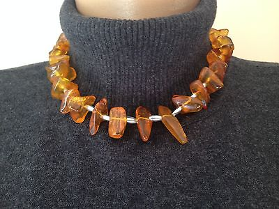 Baltic Amber and sterling silver matching chocker and bracelet, brand new in box