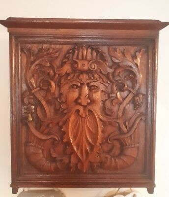Antique Carved Oak Wall Cupboard.The Green Man.