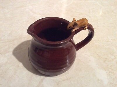 Tiny brown jug with mouse on the handle