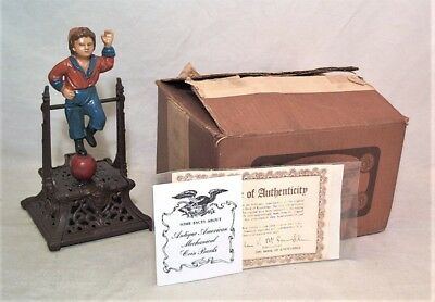 1950s BOOK OF KNOWLEDGE NO. 23 BOY ON TRAPEZE CAST IRON MECHANICAL BANK - MIB