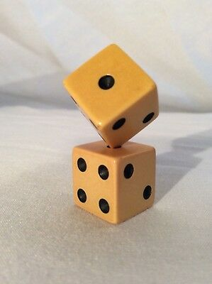 Pair of vintage dice die Yellow butterscotch tone