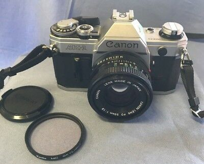 Canon AE-1 Program 35mm SLR Film Camera w/Canon FD 50mm 1.4 Lens w/bonus filter