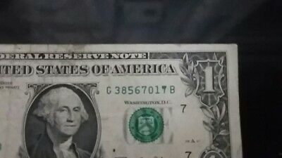 one dollar bill with defect