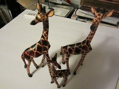 Three Wooden carved Giraffes 2 big ones and a baby one